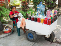 Mexican woman selling drinks Stock Images