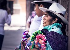 Mexican woman selling handcraft dolls stock photos