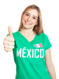 Mexican woman showing thumb up. Attractive laughing woman from Mexico showing thumb up on an isolated white background Royalty Free Stock Photography