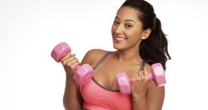 Mexican woman smiling while holding up weights Royalty Free Stock Image
