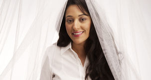 Mexican woman standing behind veil Royalty Free Stock Image