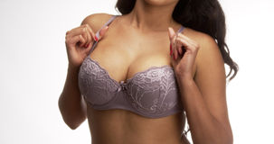 Mexican woman standing and holding bra straps. Hispanic woman standing and holding bra straps Stock Photography