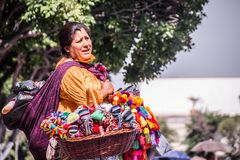 Mexican woman with traditional dress selling handcrafts royalty free stock photos