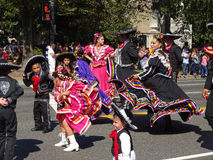 Mexican Women and Children. Photo of women and children marching in colorful costumes of mexico at the parade at fiesta dc-festival latino on 9/19/15.  Fiesta dc Royalty Free Stock Photography