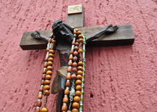 Mexican wooden crucifix with several rosaries Stock Image