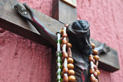 Mexican wooden crucifix with traditional prayer beads Stock Photo