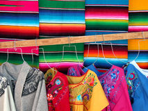 Mexican wooven sarapes and dresses Royalty Free Stock Images