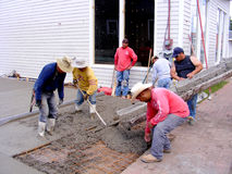 Mexican Workers Pouring Cement. Ethnic Mexican Pouring Cement for a Driveway Royalty Free Stock Photos