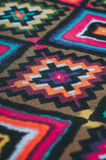 Mexican woven cotton fabrics. Closeup of a colorful Mexican woven cotton fabrics with rhombus as a background Royalty Free Stock Photo