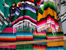Mexican woven sarapes. Mexican traditional market wool sarapes Royalty Free Stock Images
