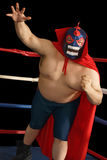 Mexican wrestler attacks. Photograph of a Mexican wrestler or Luchador standing in a wrestling ring stock photography
