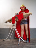 Mexican wrestler ironing his tights Royalty Free Stock Photography