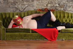 Mexican wrestler lying on a couch Royalty Free Stock Images