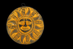 Mexican yellow ceramic sun souvenir  on black Royalty Free Stock Photography