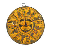 Mexican yellow ceramic sun souvenir isolated on white Stock Images