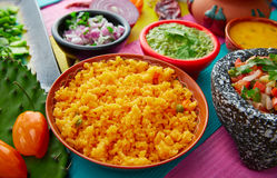 Mexican yellow rice with chilis and sauces Royalty Free Stock Photo