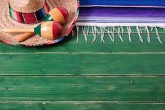 Mexico background border mexican sombrero maracas fiesta wood top edge. Mexico background border mexican sombrero maracas fiesta wood stock photography