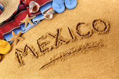 Mexico beach writing. The word Mexico written in sand on a Mexican beach Royalty Free Stock Image