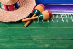 Mexico cinco de mayo wood background mexican sombrero maracas. Mexico cinco de mayo green wood background mexican sombrero maracas Royalty Free Stock Images