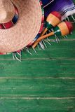 Mexico cinco de mayo wood background sombrero serape blanket maracas. Vertical royalty free stock images