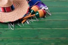 Mexico cinco de mayo wood background sombrero serape blanket mar. Mexico cinco de mayo wood background sombrero serape blanket stock photos