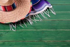 Mexico cinco de mayo wood background sombrero serape blanket rug traditional. Mexico cinco de mayo wood background sombrero serape blanket royalty free stock photo