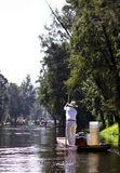 Mexico City canals. MEXICO CITY, SEPTEMBER 9, 2013: A lonely man rows his boat through Xochimilco canals. September 9, 2013, in Mexico City. The canals of Stock Photography