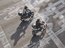 View from above of two men riding motorcycles on the street in Mexico City, Mexico stock images