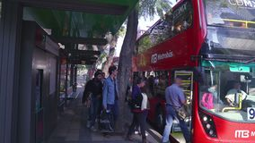 People go in and out of the metrobus station, in downtown. stock footage