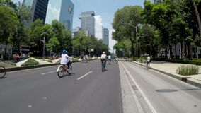 Families riding a bicycle on the avenue Paseo de la Reforma