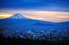 Mexico City Landscape. MEXICO CITY - FEB 23 2010:Aerial landscape view of the Popocatepetl volcano mountain rais above Mexico city.The city surrounded by