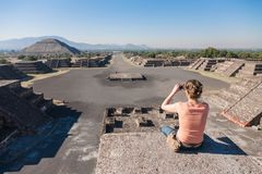 Tourist takes picture of a morning view of an epmty Avenue of Th Royalty Free Stock Image