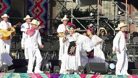Dancers perform traditional folkloric dance from Veracruz, wearing regional typical suits, as part of the cultural activities stock video