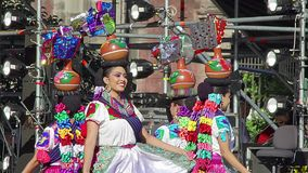 Girl dancers performs the Vases Dance, wearing a beautiful huasteca regional typical dress, as part of the cultural activities. stock video