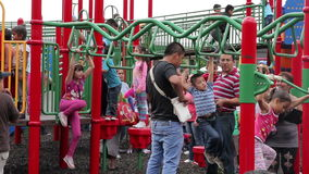 Mexico City, Mexico-August 2014: FULL SHOT. Children having fun in climbers and slides stock video