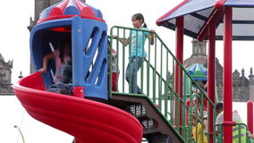 Mexico City, Mexico-August 2014: FULL SHOT. Children having fun in climbers and slides. Nowadays children between 0 and 14 years represent 30% of population in stock video