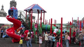 Mexico City, Mexico-August 2014: FULL SHOT. Children having fun in climbers and slides. Nowadays children between 0 and 14 years represent 30% of population in stock footage