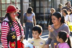 A Clown and a Family stock images
