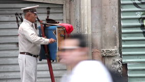 Mexico City, Mexico-August 2014: Organ grinder, playing the organ in the street. The organ grinder is a traditional character in d stock footage
