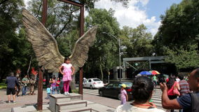 Mexico City, Mexico-CIRCA July,2014: Tourists taking pictures in wings structure in Reforma Avenue. stock video