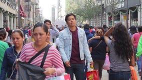 Crowd walking through street. Mexico City, Mexico-CIRCA June,2017 TAKE 1: Crowd walking through street stock video