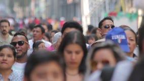 Crowd walking through street. Mexico City, Mexico-CIRCA June,2017 TAKE 2: Crowd walking through street stock footage