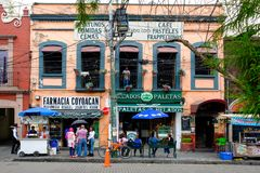 Local businesses at a colorful colonial building in Coyoacan in Mexico City. MEXICO CITY,MEXICO - DECEMBER JULY 13,2018 : Local businesses at a colorful colonial stock images