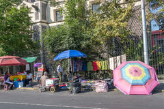 MEXICO CITY, MEXICO - FEBRUARY, 9  2015 - People buying in street shops Stock Photos