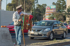 MEXICO CITY, MEXICO - FEBRUARY, 9  2015 - Poor man playing hand organ on the street Stock Images