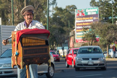 MEXICO CITY, MEXICO - FEBRUARY, 9  2015 - Poor man playing hand organ on the street Royalty Free Stock Images