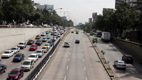 Mexico City, Mexico-June 2014: TILT UP Cars through avenue.