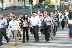 Crowds of people crossing the street near Palace of Fine Arts in Hictorical center of Mexico City Stock Photography