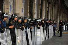 Mexico City, Mexico - November 24, 2015: Mexican Police Officers in Riot Gear outside building in Zocalo Square, Mexico City Stock Images