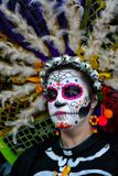 Mexico City, Mexico, ; November 1 2015: Portrait of a woman with colorful hat or penacho in disguise at the Day of the Dead celebr royalty free stock image